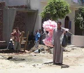 A candy man walks the streets on the West Bank at Luxor