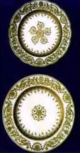 "Two golden decorated plates engraved with ""GH"" letters"