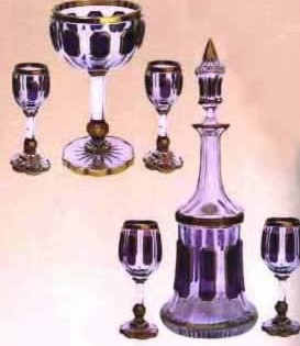 Coloured crystal cups and a bottle, Prince Youssef Kamal