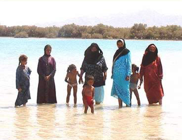 A Bedouin Family enjoying the water