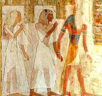 The deceased couple is led by Anubis to meet Osiris