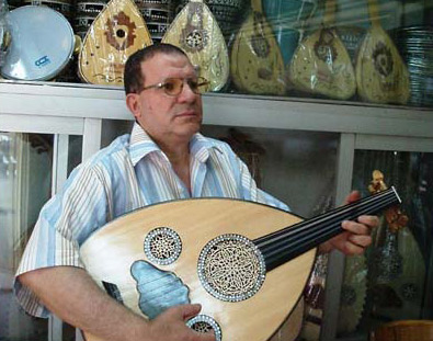 Mr. Khalil, the owner of Hamido, Playing an Oud