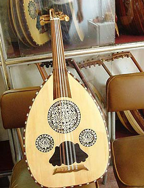 A fine wooden oud with mother of pearl decorations