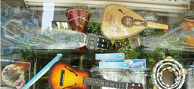 A store window on Muhammad Ali Street with various instruments, both oriental and western