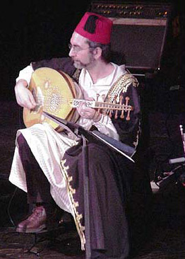 An oud being played in concert by an Egyptian