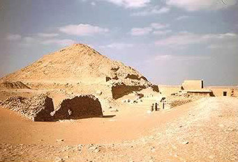 the pyramid in the background is that of Pepi II. In the foreground, the ruins are of Udjebten's pyramid.
