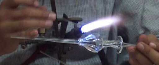 Heating glass to form the perfume bottle
