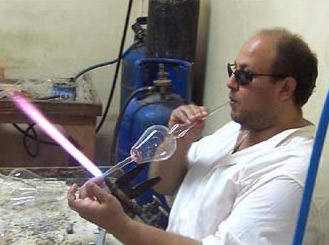 Blowing a handmade Egyptian perfume bottle
