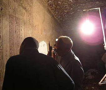 Officials examining the reliefs within the tomb