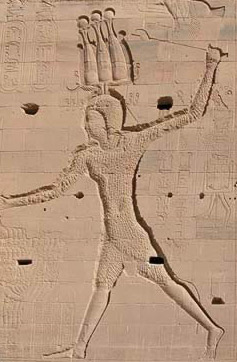 Ptolemy XII Slays the enemies of Egypt on the front wall of the Fist Pylon at Philae