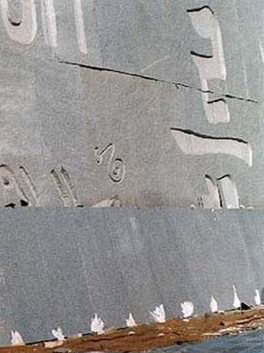 Details of inscribed calligraphy next to edge of water pool
