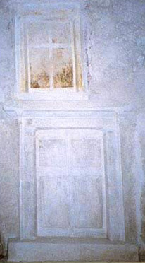 Loculi sealed with slabs painted on stucco with representations of doors and windws modeled on local houses of the Greek Period