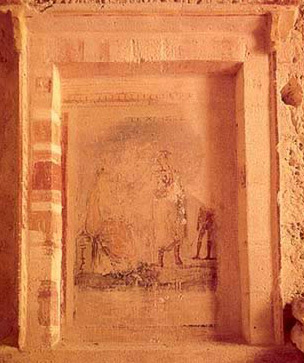 A room with a loculus sealed by a slab with a dexiosis scene consisting of a man clasping his wife's hand in farewell