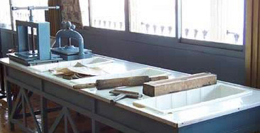 A complete papyrus manufacturing table including vats for soaking and press