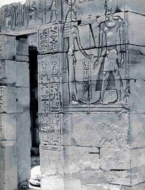 South Wing of the Pylon, East Facade - Ptolemy IV advancing towards Hathor