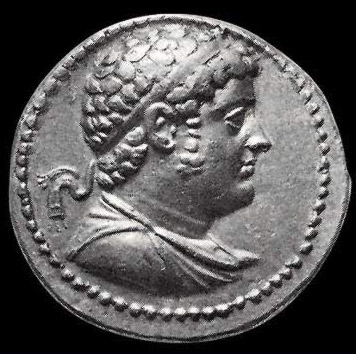 An ancient Coin depicting Ptolemy IV Philopator