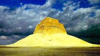 The Ruined pyramid of Snefru standing at Meidum seems to rise above a primeval sea