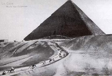 A very early photograph showing tourists arriving at the Great Pyramid