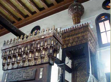 A good vieew, showing the upper elements of the Minbar, including the bulb, the ceiling treatment and the stained glass windows
