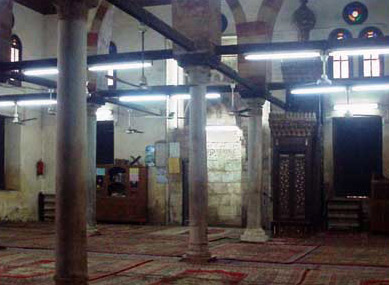 A general view of the mosque with the Qibla Wall, including the Mihrab and Minbar visible