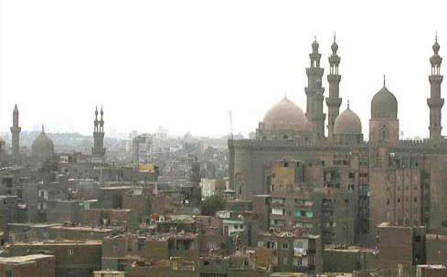 View of Islamic Cairo showing Sultan Hassan mosque and school and the Qanibay Complex.