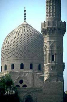 The dome and minaret of the Qurqumas complex in Cairo, Egypt
