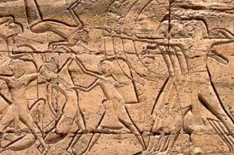 Bowmen of Ramesses III's infantry fire arrows at the Libyan enemies