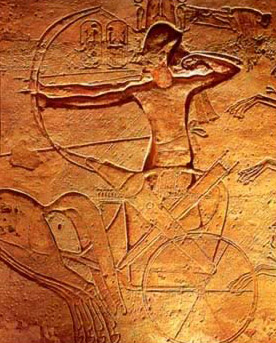 Ramesses II standing along in his two man chariot firing arrows