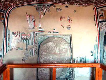 The back wall of the tomb