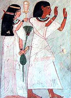 Roy's wife holds a sistrum and a roll of papyrus