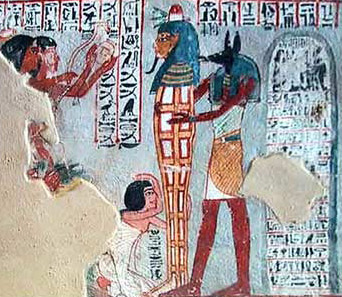 The mummy of Roy with Anubis behind him
