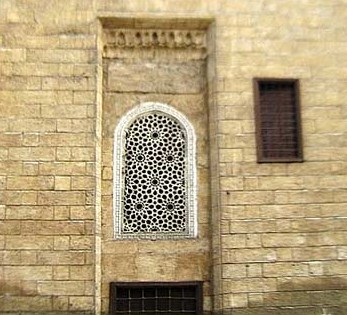 Facade of the madrasa showing one of the wonderful windows