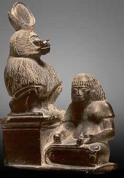 Thoth as a baboon, with a scribe at his feet