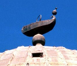 The boat surmounting the  dome of the Mausoleum