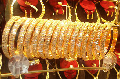 Large, heavy golen bracelets sparkle in the El Sagha Jewelry district of Cairo