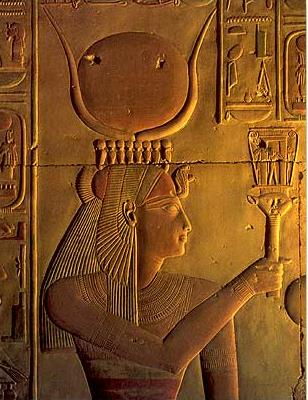 Isis, largely in the guise of Hathor, holds a naos-style sistrum