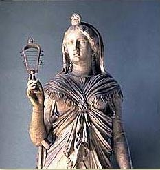 A roman marble statue of Isis, dating to the 2nd century AD, holding a sistrum