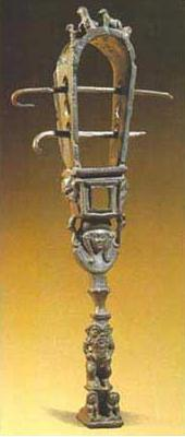 A fairly good example of a hoop sistrum, with Hathor's head at the top of the handle and Bes at the bottom, but missing its metal disks. This one dates to the Greco-Roman era and is made of bronze
