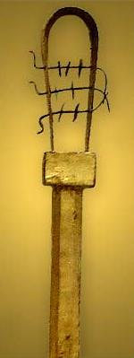 This very undecorated sistrum from the tomb of Tutankhamun doubtless was made during the Amarna Period