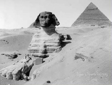 The Giza Sphinx, partially buried in the sand, from an old photograph