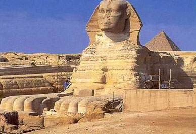 The Great Sphinx of Giza, with workmen doing restoration on its right side