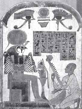 A painted wooden stela showing the singer of Amon playing a harp, with Wedjet-eyes in the lunette
