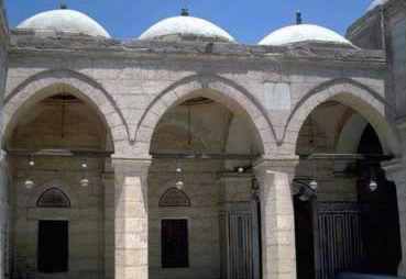 domes above the arcade of the mosque courtyard