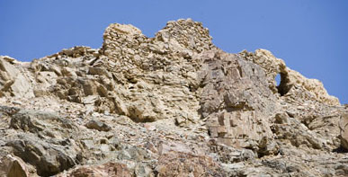 The walls at the top of a  cliff belonging to the ancient church at the Feiran Oasis
