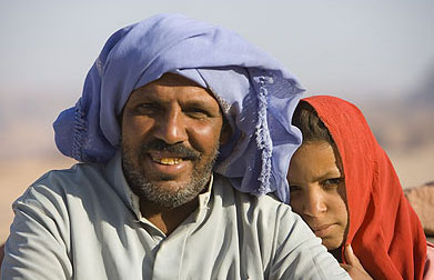 A bedouin and his  daughter, seemingly out in the middle of nowhere