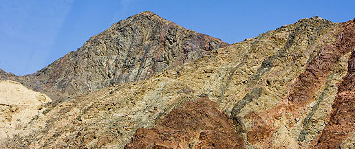 Colors, in the form of various minerals, seem to cascade down a Sinai Mountain