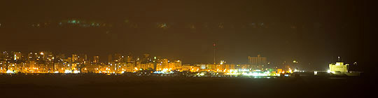 A view of Alexandria at night with Fort Qaytbey to the far right