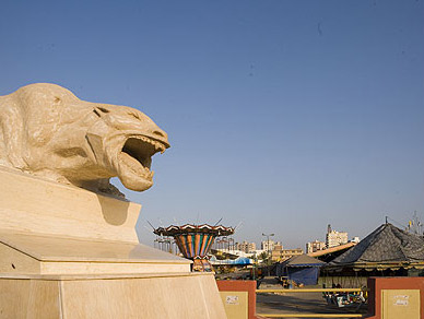 A statue of a panther, actually adorning the entrance to a boulevard leading to the Gulf of Suez, seems to take offense at one of Suez's several carnivals.