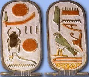 In the cartouches of Horemheb, a number of figures can be seen as ideographic representations of a figure or object in the form of a hieroglphic sign, such as the hawk and the scarab, among others