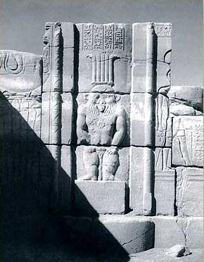 Relief of Bes in the pylon entrance of the main temple of Mut